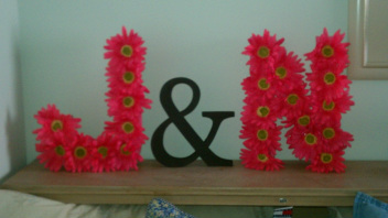 i put these monogram letters together with paper mache letters from hobby lobby i painted the letters pink and then hot glued the daisies onto them